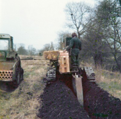 Barth K140 Trencher installing clay tile drains (1970s)