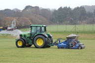 Shown installing sand banding to established pitch