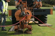 Shown installing irrigation lateral pipework around a green