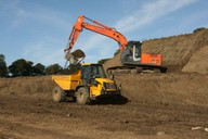 Shown loading JCB 714 dumper - 14 tonnes
