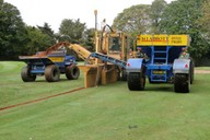 Shown installing primary land drainage to a golf fairway