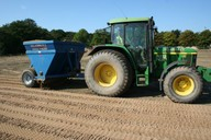 Used for spreading sand or rootzone onto surfaces prior to amelioration