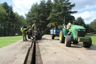 Used in small areas - shown being used to install golf greens drainage