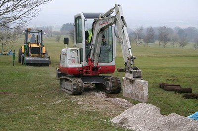 Takeuchi TB125 fitted with backfilling blade