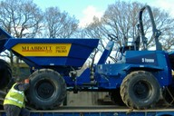 Used on civil engineering projects - swivel skip allows materials to be discharged either side of machine