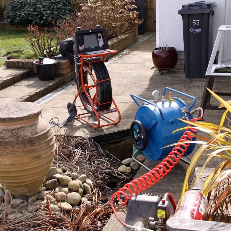MJ Abbott drains team avoids digging up a customer's patio