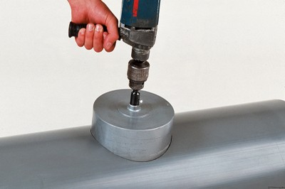 To fit, a hole is first drilled in the main pipe using a cordless drill and hole saw