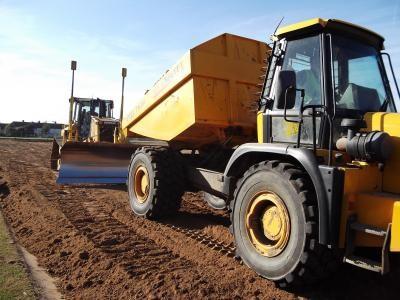 Laser guided dozer re-spreading topsoil