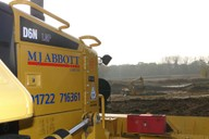 D6N ready to spread and shape the excavated material from the lake extension