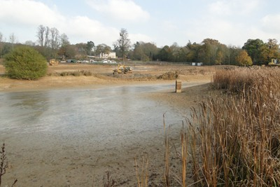 Existing lake drained down and earthworks in progress, extending the lake and shaping the surrounds