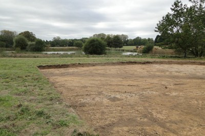Initial topsoil strip in area of archaeological interest