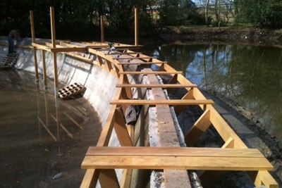 New Opepe timber walkway under construction between clay and concrete Victorian swimming pools