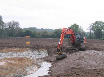 Shaping wetlands using Engcon attachment