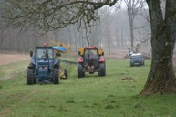 Mole plough and gravel cart under trees