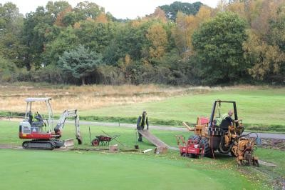 Moleploughing greens lateral pipework