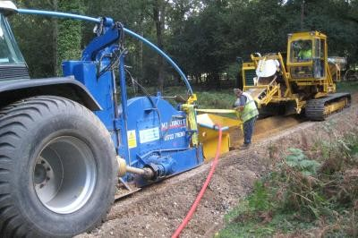 Cable and pipe installation showing sand placement