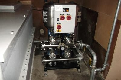 Twin booster pump with variable speed motors