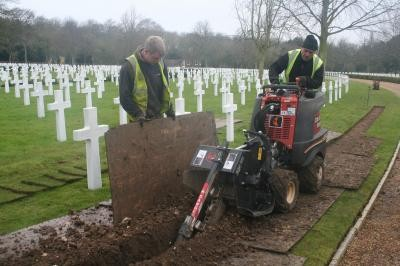 Trenching between headstones