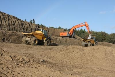 Loading topsoil for respread from weathered heaps