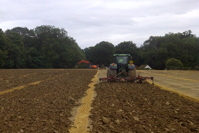 Shallow cultivation of topsoil following drainage installation