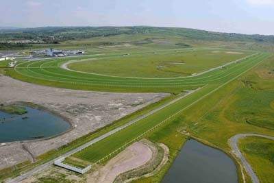 Racecourse with irrigation lakes in foreground