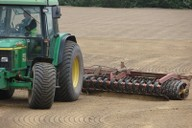 Grade rolling to existing pitch surface