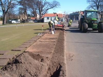 Installation of putting green lateral pipework