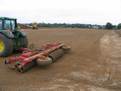 Grading pitch ready for seeding