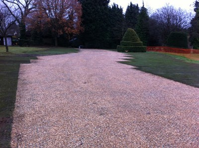 Gravel filled access with pre-grown turf filled bays on fast lay