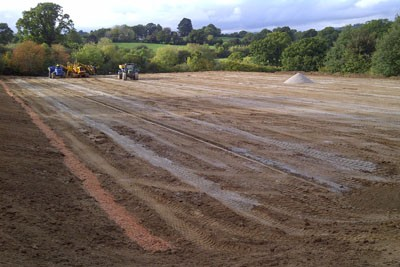 Drainage installation to pitch following earthworks and topsoil re-spread