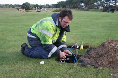 Engineer installing fairway sprinkler