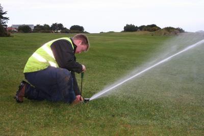 Engineer testing sprinkler