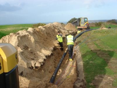 Service trench installed through golf course