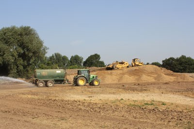 Bulk earthworks with scraper and box, dust suppression on haul routes
