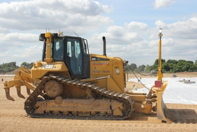 CAT D6N dozer with 3D Total Station grading attachment spreading a gravel raft layer