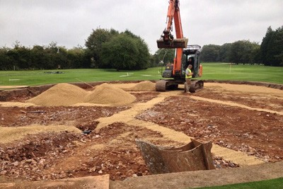 Installing drainage on 11th Green