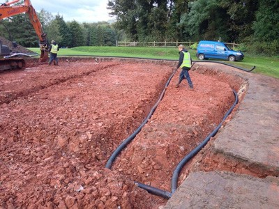 Installing drainage on 18th Green