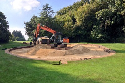 Installing gravel carpet on 9th Green