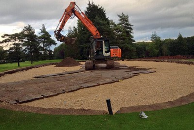 Installing rootzone on 14th Green