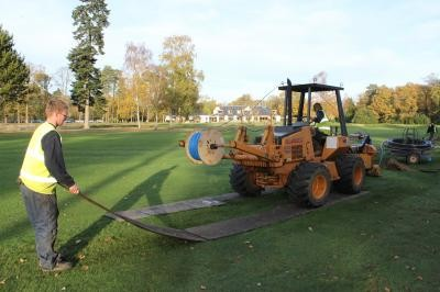Moleploughing fairway lateral pipework