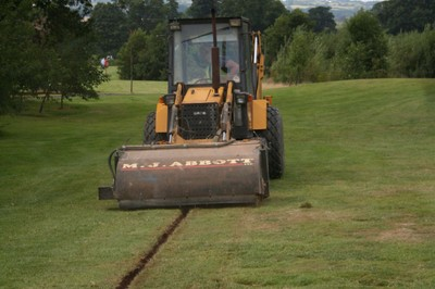 Cleaning trench lines with mechanical sweeper