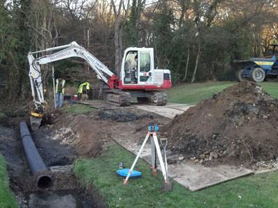 Excavating base for sleeper installation