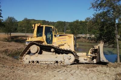 Dozer regrading the lake edge
