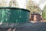 Irrigation water storage tank and pumphouse