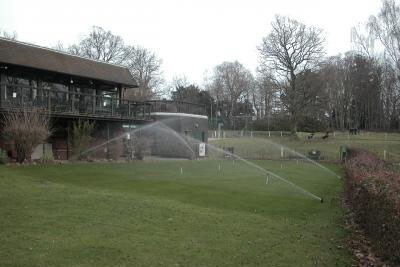 Sprinklers operating on the putting green