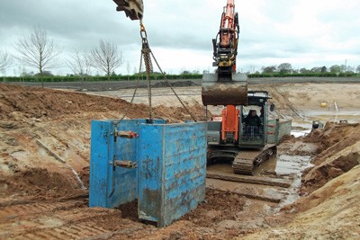 Back lake under liner drainage chamber installation