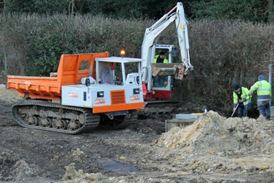 Due to the wet ground conditions, a tracked dumper was required to transport materials