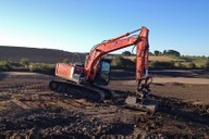 Hitachi excavator carrying out shaping works