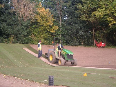 Laying big roll turf to the 5th Tees