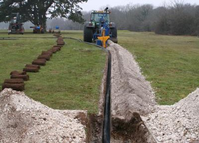 Mainline pipework and cable installed in open trench
